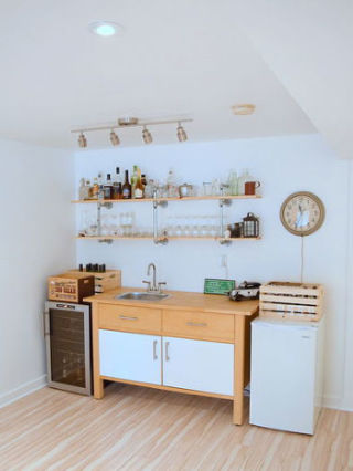 Turn an unused area of your basement into a kitchenette-slash-bar for an alternative spot to entertain guests. Blogger Alex ofNorthstory created a welcoming, vintage vibe with an antique wall clock, wooden crates, and pipe shelving. See more of this project atHomeTalk.