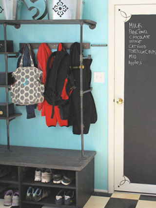 With some pipe shelves and a small bench, you can turn a corner of your basement into a mudroom for out-of-the-way coat and shoe storage, like blogger Jill of Junky Vagabond. See more of this project at HomeTalk. NEXT: The Best Ways to Organize Your Storage Spaces