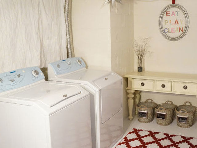 With a few coats of paint and a bright rug for color, the basement, featured on Maggie May's Gifts, becomes a much more welcoming place to do laundry. See more of this project on HomeTalk.