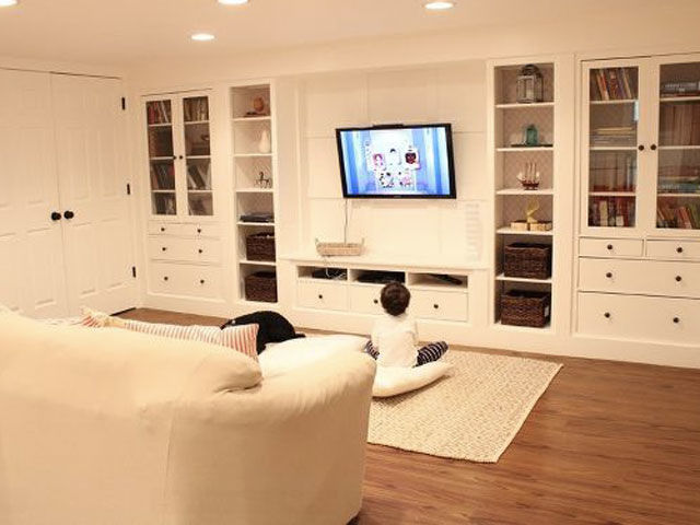 Installing bright-white Ikea built-ins took this basement from stark to sleek, adding even more living space to the home of the blogger behind No. 29 Design. See more of this project at HomeTalk. RELATED:  Smart Storage Units For Your Home's Nooks and Crannies