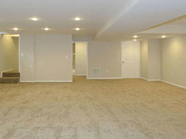 The owner of this carpeted basement wasn't making the most out of the space.