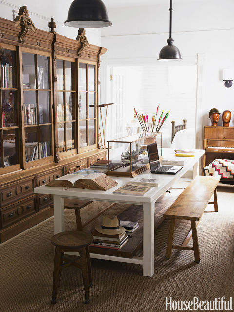 Designer Myra Hoefer's California home's unique library and office features a large table perfect hosting dinner parties.