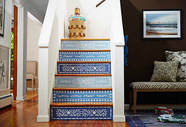 This staircase, featured on One Kings Lane, started off a boring, basic white-and-wood style. To mix it up, the designer painted each stair face a different shade of blue, and then added delicate-looking stencils inspired by bone inlay furniture. See the makeover »
