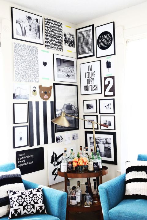 You don't need a large wall for your dream gallery — a corner works nicely. A Beautiful Mess used this blank space to create an eye-catching, monochromatic display. See more from this room »