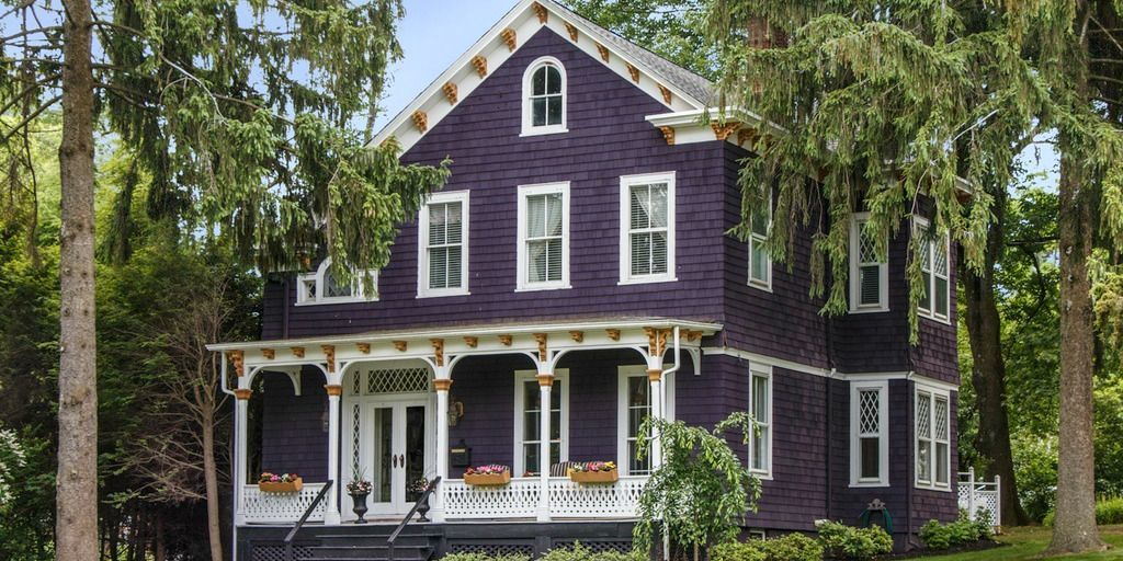 Purple victorian home purple exterior paint colors for Historic house colors exterior