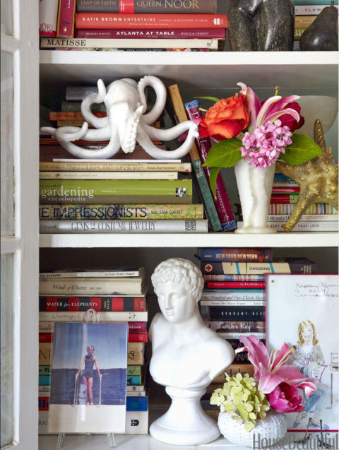 Living room bookshelves offer another spot for Gregg to display objects and mementos.