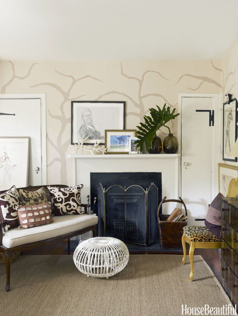 An artful seating arrangement surrounds the bedroom fireplace.