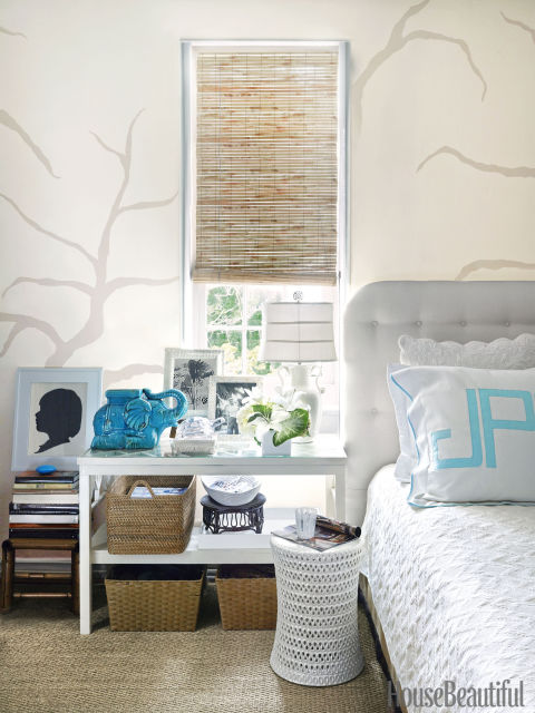 Turquoise accents, including monogrammed pillows by Leontine Linens, punch up the neutral backdrop of the master bedroom.