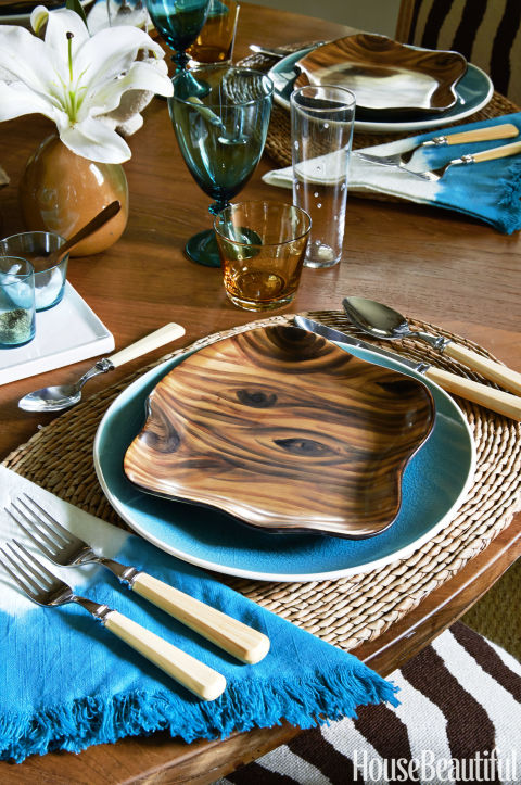 Faux-bois plates, a T.J. Maxx find, bring out the warmth of the wood table by Elizabeth Stuart Design.