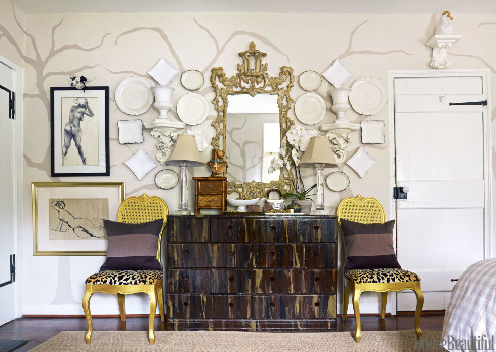 For a dash of glamour, Gregg painted her childhood chest of drawers in tortoiseshell tones and thrift shop chairs in metallic gold. Inexpensive plates and urns, all from T.J. Maxx, are hung like a collage. Mirror, Boca Bargains.
