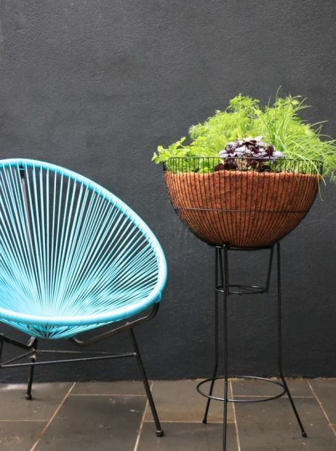 This sculptural planter is made from half a birdcage and an old wire stand.<br />See more at My Poppet »<br />