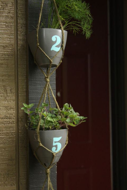 Knotted rope suspends these planters, which display this home's address number.<br />See more at Think Crafts »<br />