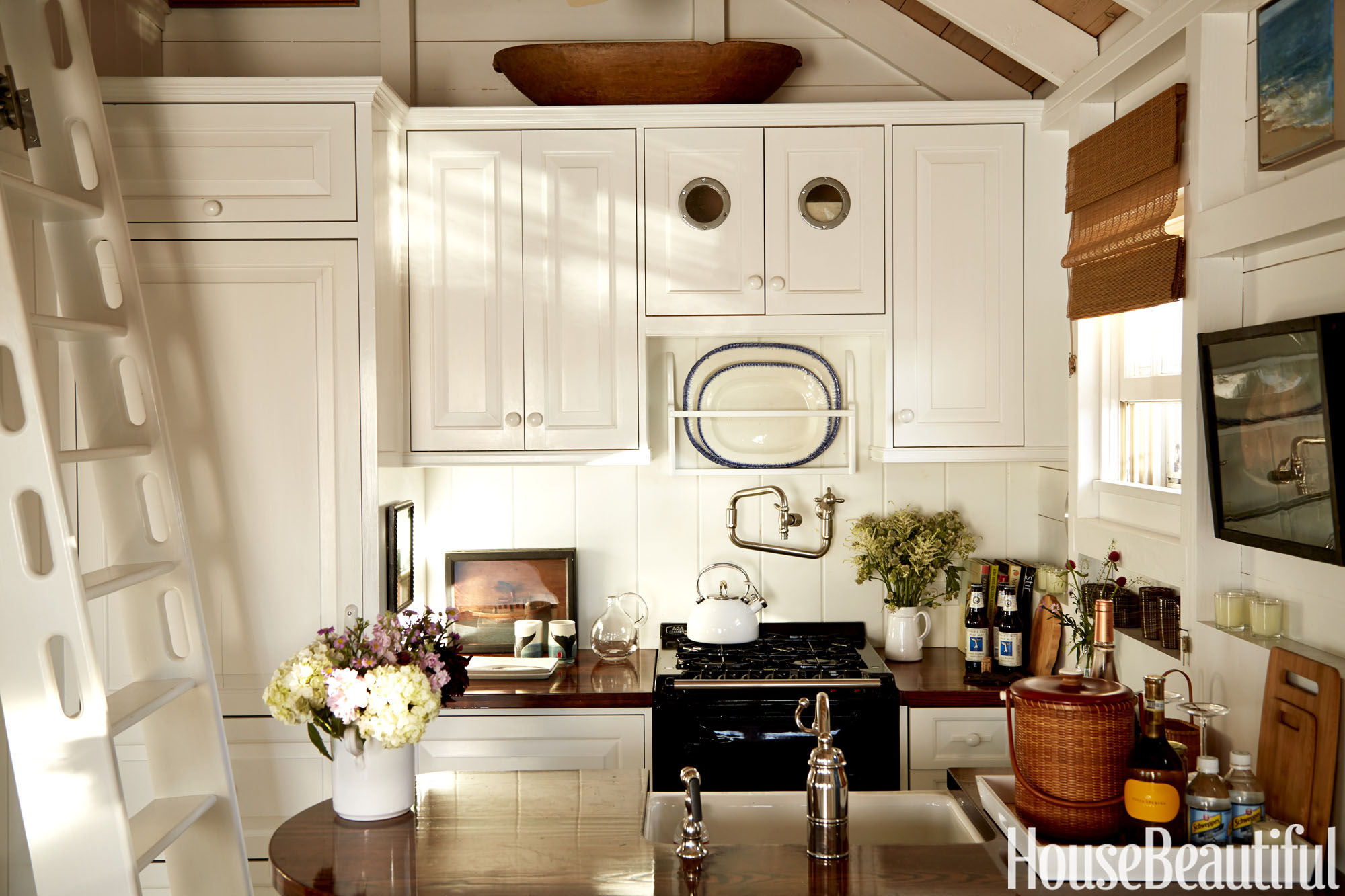 Nantucket boathouse tour designer tips for Boat kitchen cabinets