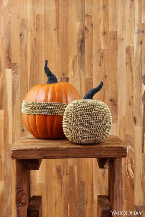 Bead garland is inexpensive, but it looks elegant when wrapped around a pumpkin. Gold makes for a classy contrast, but you can also try black or purple — classic Halloween colors. Get the tutorial at Yahoo! DIY » What you'll need: bead garland ($8, amazon.com), duct tape ($7, amazon.com)