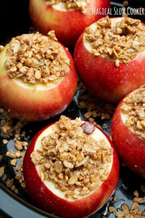 "We love a treat that's a feast for the eyes, taste buds, and nose — and these comforting cinnamon granola apples say ""fall has arrived."" Get the tutorial at The Magical Slow Cooker »"