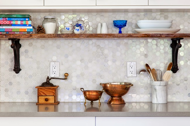 The key here is making sure you install the shelves high enough so items like cooking utensils or spices can still fit below them. If you hang a shelf in the sweet spot, you'll double the storage space under your upper cabinets. See more at The House Diaries »