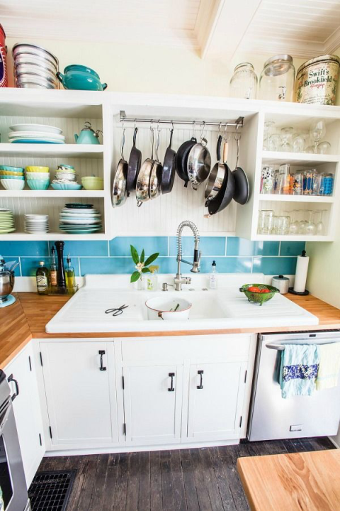 This idea is a two-for-one: Not only does it use up wasted space, but it also serves as a drying rack for pots and pans. Hang and let them drip dry after you wash them. See more at Farm Fresh Therapy »