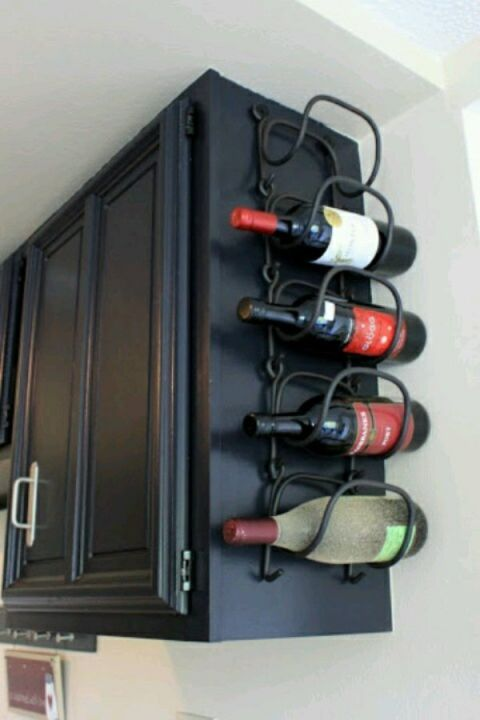 Instead of taking up space with a bar cart, hang a wire holder from the side of a cabinet. Even better? Hang it from the cabinet that holds the wine glasses so all the essentials are within reach after a long day.<br />See more at Between 3 Sisters »<br />