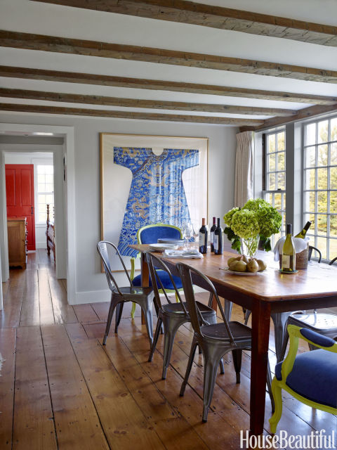 Swap out your formal chairs (in this case, bright blue and green ones) for a few rustic metal ones. Designer Ramsay Gourd did this to create a more casual atmosphere in the dining room.