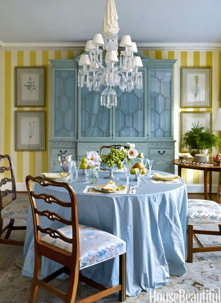 Redd brought in a breakfront to anchor the space and had it painted in one of his mother's favorite colors, an 18th century-inspired chalky green. A table skirt made from taffeta is a soft contrast to the mahogany ladder-back chairs.