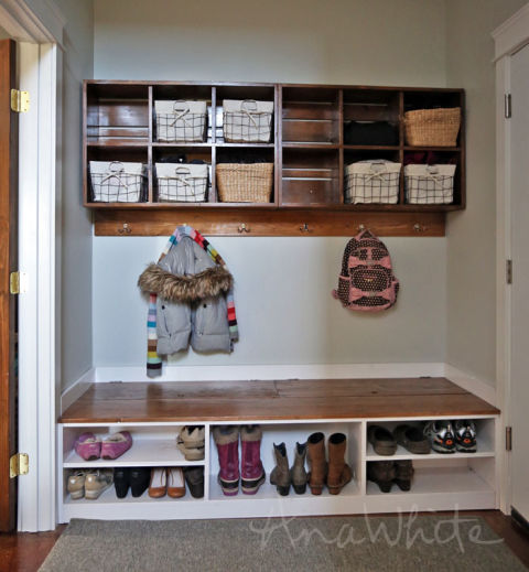 A tall compartment for boots? Check. Shorter compartments for flats and kids' shoes? Quadruple check. This built-in bench provides enough space for the entire family's footware. See more at Ana White »