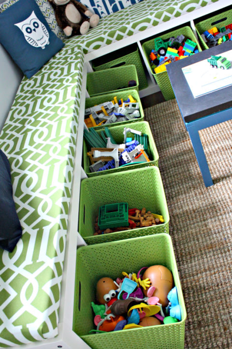 Provide a place for your little ones to sit when they have friends over (and a place to put toys away afterwards) with this bright green bench-and-bins combo.See more at I Heart Organizing »