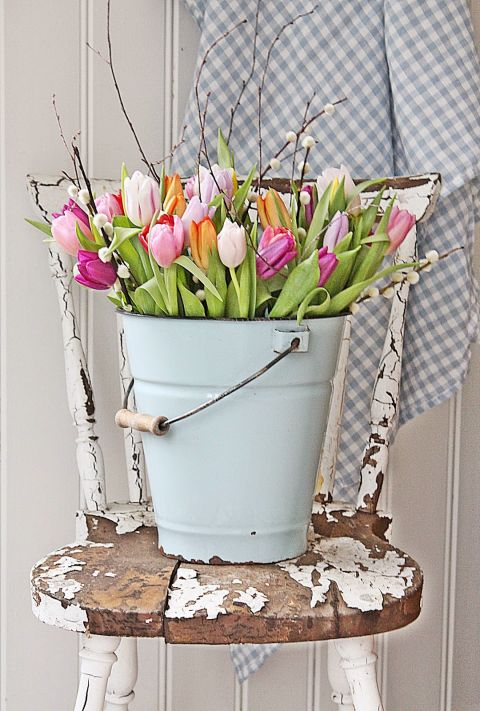 Arrange the springtime staple in unexpected containers, like buckets or umbrellas. Get the tutorial from Vibeke Design »