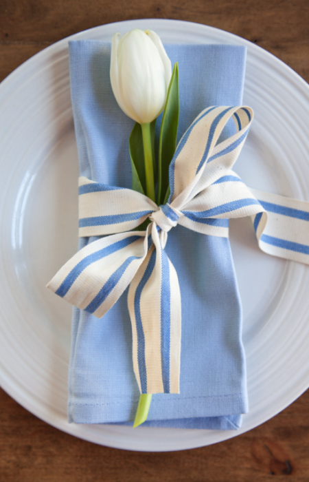 A white tulip and coordinating ribbon are all you need for a springy napkin ring. Get the tutorial from Boxwood Clippings »
