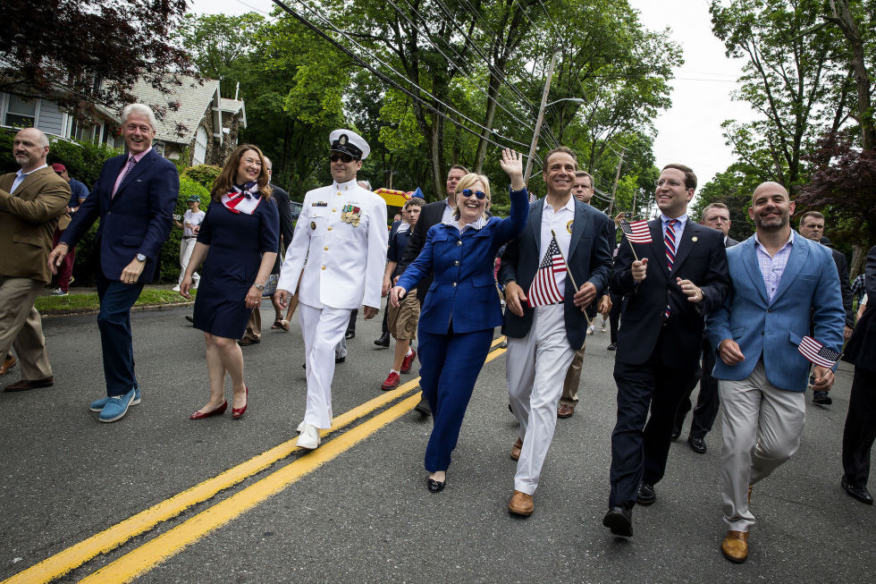 In high campaign mode, Hillary walked in the town's 2016 Memorial Day march alongside Bill and New York Governor Andrew Cuomo — but she's done so multiple times over the years.