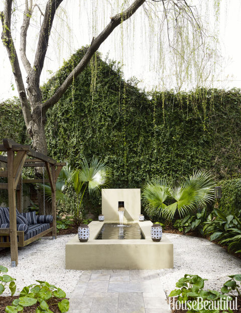A weeping willow hovers over the water feature outside of Jill Sharp Weeks' Charleston rental.
