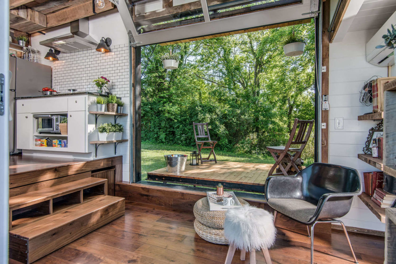 inside a tiny house with a pop out deck alpha tiny home by new
