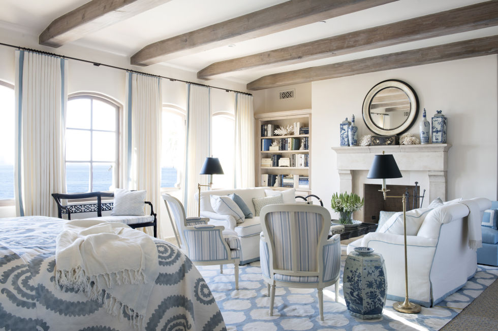 "Designer Mark D. Sikes, author of the new book Beautiful (Rizzoli, $45; amazon.com), has a soft spot for the timeless country combo of blue and white. While Mark's beloved stripes certainly have a place in this bedroom (note the French armchairs and the tape trim on the window treatments), the designer's favorite accents here are the blue-and-white ceramics—from porcelain jars on the mantel to the garden stool side table. ""You can use ceramics sparingly as an accent, but I like a lot of pieces displayed together as a collection. It gives instant color and detail that's intricate and alluring,"" he says. He lists John Rosselli Antiques and Middle Kingdom as his go-to sites. When doing your own searches online, use the key words ""ginger jar"" or ""temple jar."""