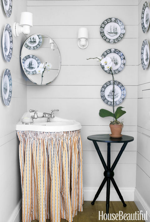 Not everything has to line up flush. A corner sink maximizes every inch, while clutter can hide behind the fabric skirt.