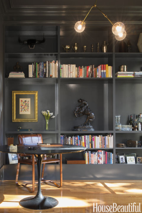 "Black built-ins are popping up everywhere lately, like in this study by Carmel Greer. ""This gray-black reminds me of shadows — for me, that's a good thing,"" she says. ""With the gold overhead light and leather chair, it's tailored and masculine, not cave-like."" Get this paint color: Clark+Kensington Black Chiffon N-C15"