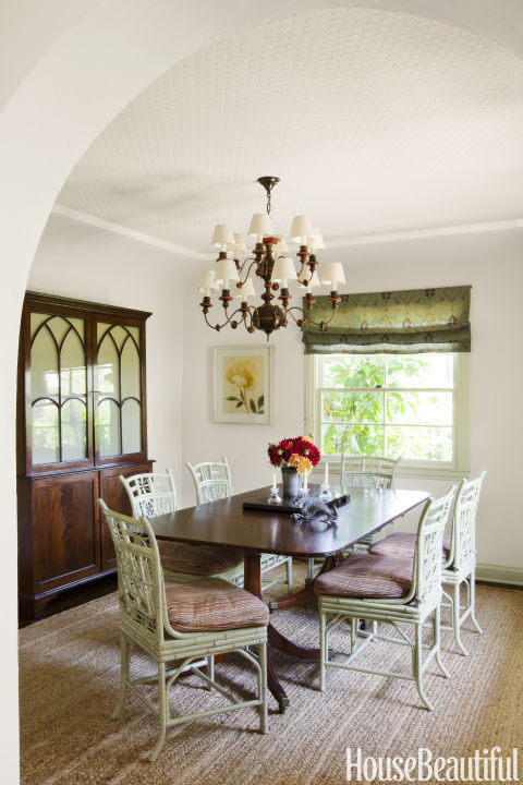 "If sunlight is hard to come by, fake it via paint color. ""Not every room can have a dozen windows. When there's only one, like in the dining room of this Spanish-style home, you have to emphasize it,"" says designer Christine Markatos Lowe.  Get this paint color: Farrow & Ball Stone White 11"