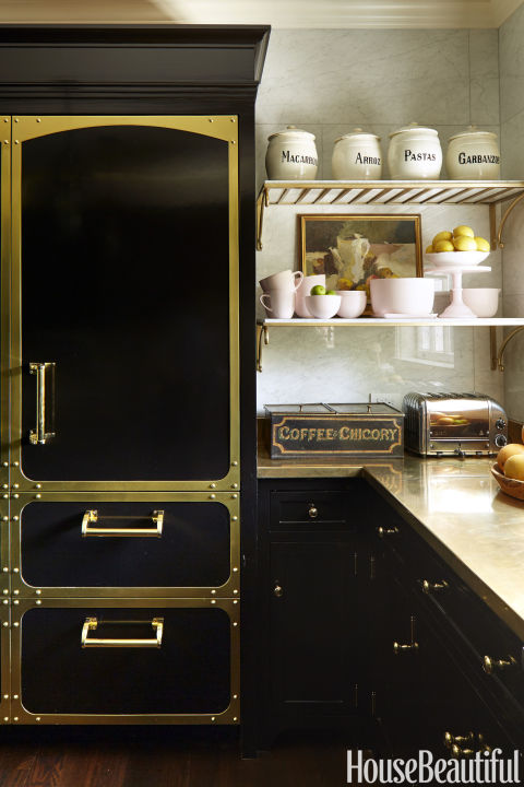 In The Kitchen A Brass Counter And Hardware Gleam Against Cabinetry And Sub Zero