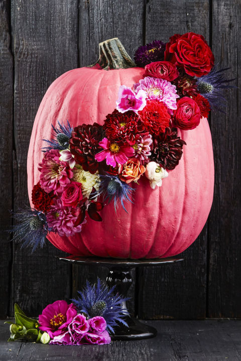 Step it up from last year's pumpkin vase and decorate the actual gourd with blooms. A drill can quickly poke holes through the rind in whatever pattern that comes to mind.  Get the tutorial at Good Housekeeping » What you'll need: cordless drill ($58, amazon.com), pink spray paint ($7, amazon.com)