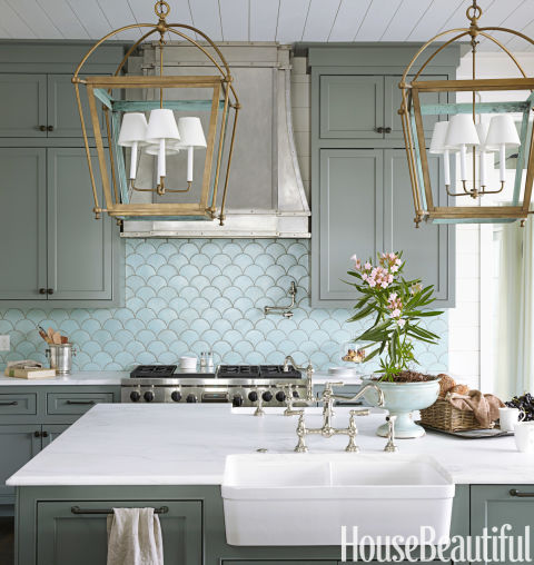 The ocean's shimmery hues inspire a kitchen in Santa Rosa Beach, Florida, by Urban Grace Interiors. The ocean's shimmery hues inspire a kitchen in Santa Rosa Beach, Florida, by Urban Grace Interiors. The blue-green wall tile sets the tone, reminding the designers of verdigris — the color you see on the inside of the brass lanterns.