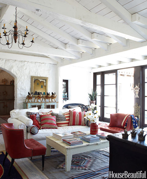 "The living room in designer Kelley McDowell's Ojai, California, farmhouse, is filled with American flag accessories. ""There's something about the American flag that moves me,"" she says."