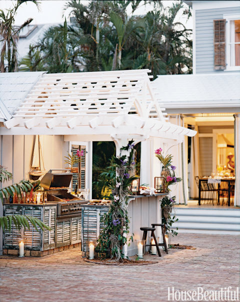 "In Malcolm James Kutner's Key West house, the outdoor kitchen cabinets are made from old cypress shutters supplied by restorer Liz Devries. ""With outdoor living in general, it's about being friendly with nature and inviting it inside instead of trying to draw that heavy line in the sand that says, 'This is the outside and this is the inside,'"" he says. ""Key West is all about living harmoniously with nature."""