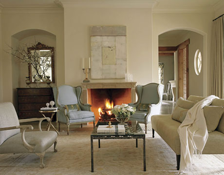 White Living Room With Blue Armchairs And Fireplace