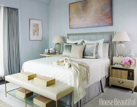 master bedroom with light blue walls and white bedding