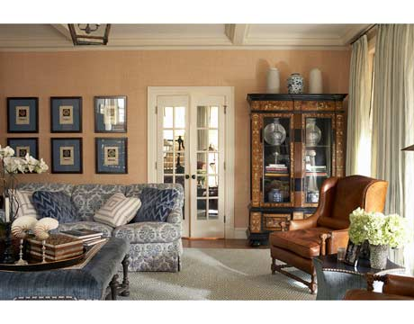 The family room's sofa, from the Atelier Branca line, is upholstered in Le Gracieux's Regello in Bay on Soft Blue — but first Branca had the fabric outline quilted for extra coziness and durability. She bought the Renaissance Revival fruitwood, ebony, and ivory bookcase in Holland and filled it with old and new porcelain vases from her store. The carpet is from Shyam Ahuja.