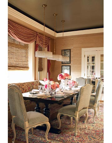 To add youthful spirit to the dining room, Branca hung a trio of 1950s Venetian de Majo chandeliers from Craig Van Den Brulle over the Jacobean-style refectory table. Her mix of patterned textiles includes Bennison's Pandaranda on the banquette, Nobilis's Manoir in Pale Blue on painted Louis XV–style chairs.