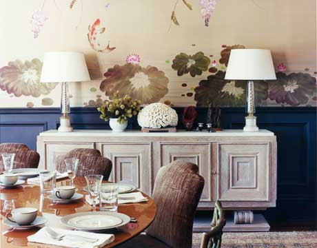 In a new Greenwich, Connecticut, house, designer Joe Nahem gave the dining room timeless allure with a hand-painted and embroidered silk wallcovering, Fromental's Lotus & Carp in Moon Gold.