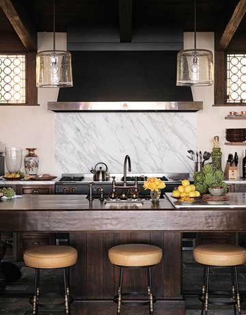 Traditional and modern blend in the kitchen. Venetian-style windows let in light while preserving privacy. Stools by Paul Ferrante. Word Pendants by Alison Berger.