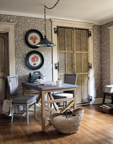 In the library, antique French shutters serve as closet doors.