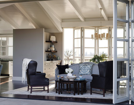 a gray and blue living room with sliding walls - Farmhouse Interior Design Ideas