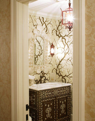 Enchanted forest meets princely bower, thanks to HB Home's pairing of woodland wallpaper with an inlaid cabinet they converted into a vanity.