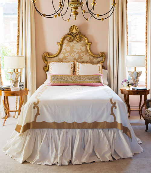 master bedroom with pink walls and antique headboard
